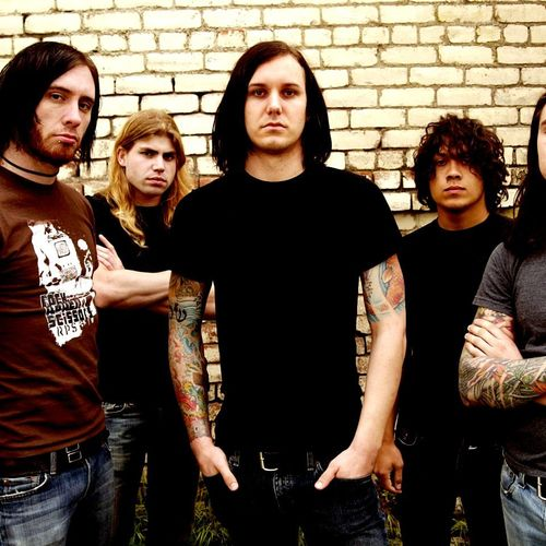 as i lay dying a The group formed as a trio in 2000 with vocalist tim lambesis, drummer jordan mancino, and guitarist evan white, and shortly thereafter released beneath the encasing of ashes.